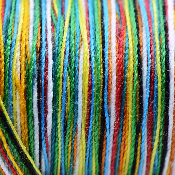 Close up of brightly colored threads