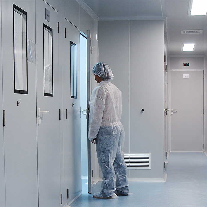 Scientist going into a room in a laboratory